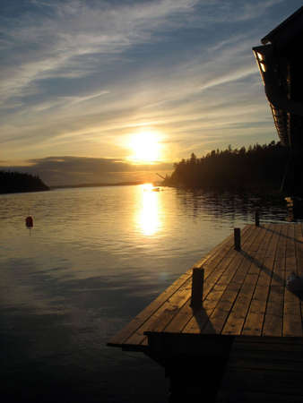 Pier in sunset in the archipelago in Northern Europe photo