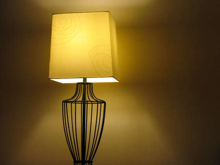 metal base: Lamp with a beige shade and metal base