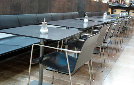 Restaurant or cafe with tables and chairs