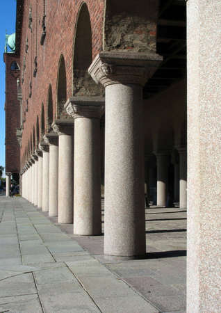 Pillars at an entrance to a giant beautiful building photo