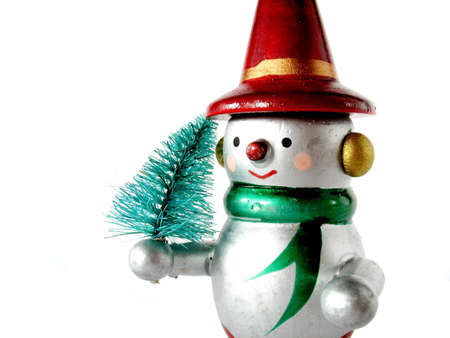 Snow man with a little christmas tree, isolated on white photo