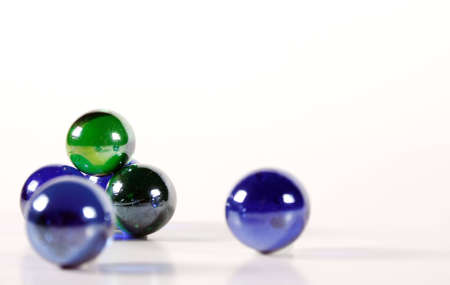 Marbles in various colors on white background