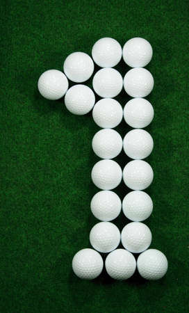 ultimate: Golfballs showing the goal in golf, hole in one Stock Photo
