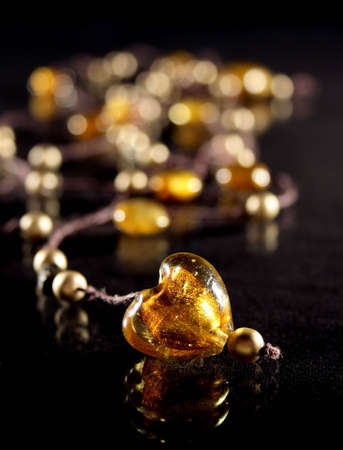 accesory: Amber heart on necklace with golden pearls