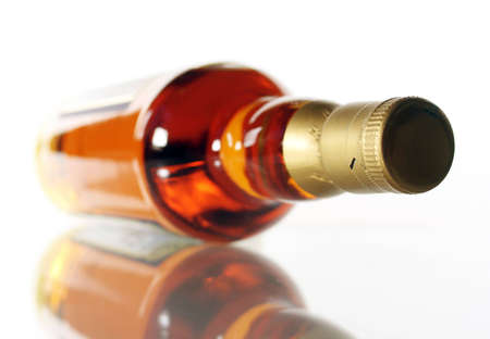 Bottle of whisky on white background with reflection