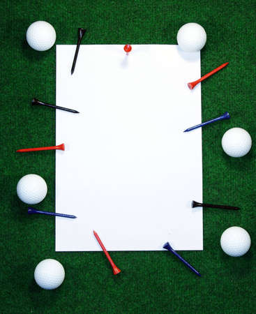 Golf note with white message area with balls and pegs. photo