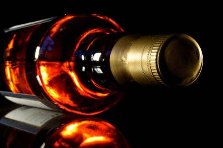 Bottle of whisky with black crisp background photo