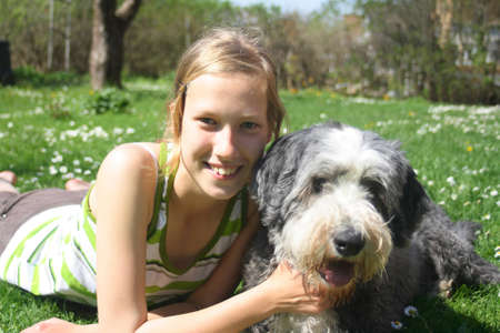 Girl and dog, bearded collie, as best friends Stock Photo