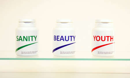 longevity drugs: Sanity, Beauty and Youth pills in a bottle on bathroom shelf, fake brands Stock Photo