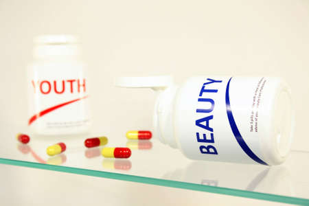 longevity drugs: Beauty and youth pills in a bottle on bathroom shelf, fake brands Stock Photo