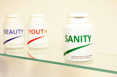 longevity drugs: Sanity, Beauty and Youth pills in a bottle on bathroom shelf with focus on Sanity, fake brands
