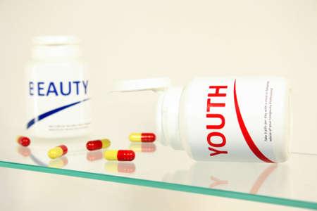 longevity drugs: Youth and beauty pills in a bottle on bathroom shelf, fake brands
