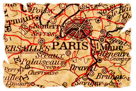 Paris on an old torn map, isolated. Part of the old map series. photo