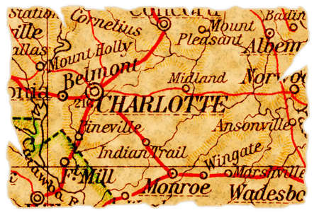 Charlotte, North Carolina on an old torn map from 1949, isolated. Part of the old map series. Stock Photo