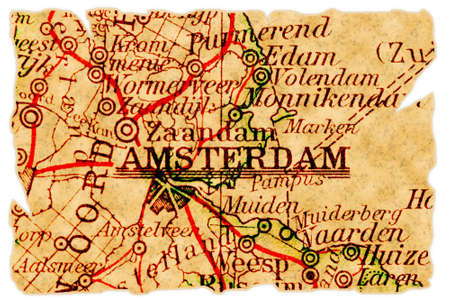 Amsterdam, The Netherlands on an old torn map from 1949, isolated. Part of the old map series. photo