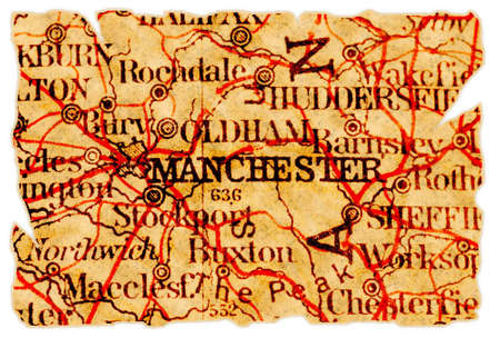 Manchester, United Kingdom on an old torn map from 1949, isolated. Part of the old map series. photo