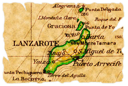 Lanzarote, Canary Islands on an old torn map from 1949, isolated. Part of the old map series. Foto de archivo