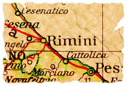 Rimini, Italy on an old torn map from 1949, isolated. Part of the old map series. photo