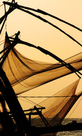 Chinese fishing net in the sunset by the ocean