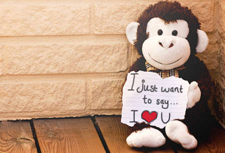 message: A monkey with the message I love you Stock Photo