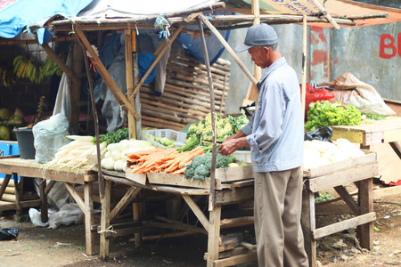 merchant: Market street in Indonesia with merchant and vegetables