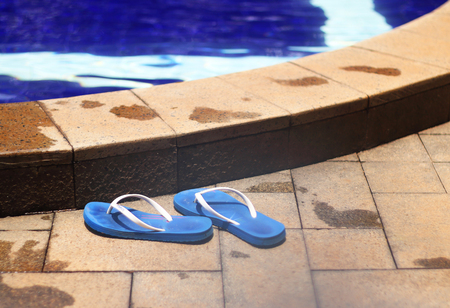 flipflop: Blue flip-flop shoes by the nice poolside
