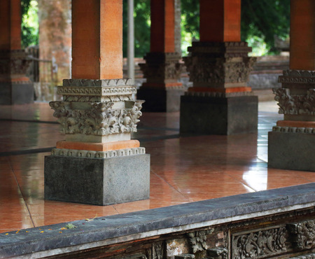 Hindu temple with strong red pillars and shiny floor