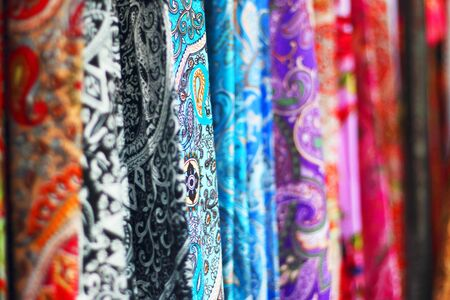 Colourful scarfs in a row at the market