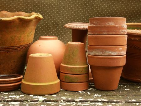 terra cotta: artful display of terra cotta flower pots of various shapes, sizes, and ages