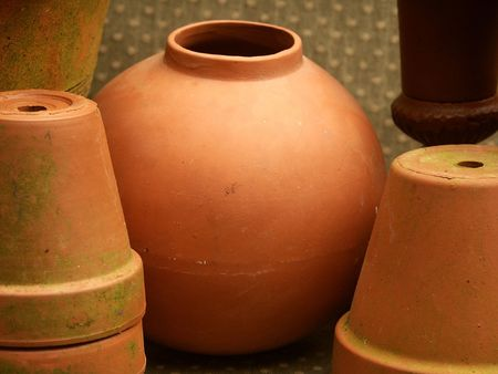 terra cotta: round terra cotta pot among other flower pots