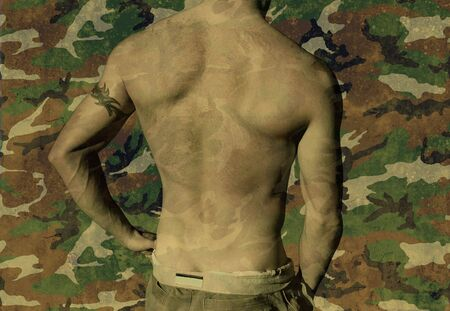 sexy army: Shirtless youth with tribal tattoo on a military camo background