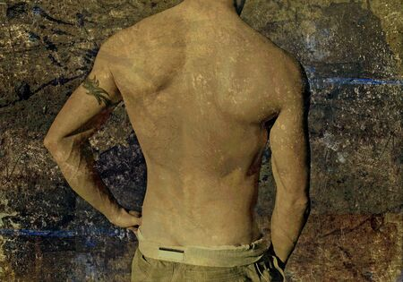 man ass: Shirtless young man with tribal tattoo on a grunge background Stock Photo