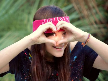 Pretty Smiling Teen Girl in Braces Making Heart Sign With Hands Stock Photo - 4787366