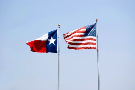 Texas Flag and American Flag Waving in the Breeze