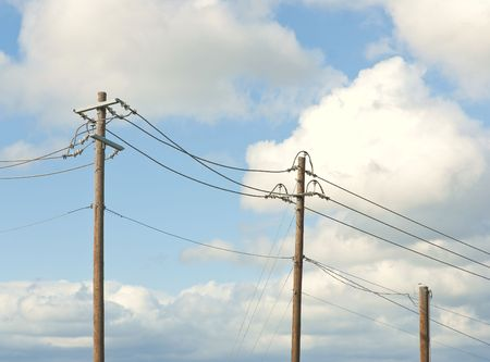 Telephone Poles Against a Pretty Blue Sky Stock Photo
