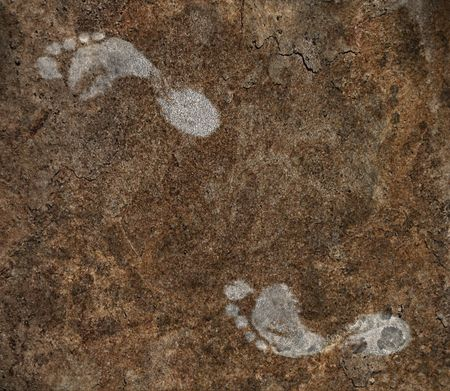 Mysterious chalky human footprints on rock