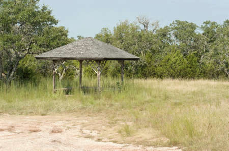 Rustic gazebo in tall grass near the shore Stock Photo - 8874710
