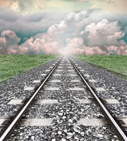 Railroad tracks leading to a distant light