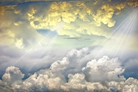 Beautiful rays of light in dramatic clouds  Stock Photo