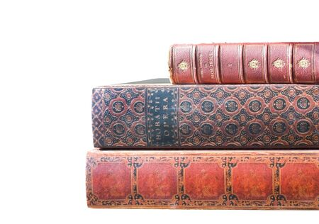 Stack of old leatherbound books isolated on white