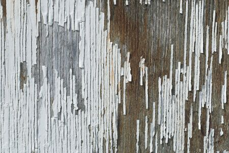 Peeling paint on the side of an old barn