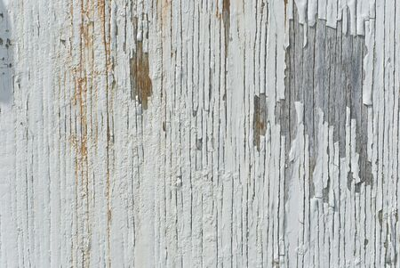 Peeling paint on the side of an old barn photo