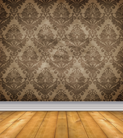 Empty room with shabby damask wallpaper and bare wood floor photo