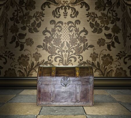 locked: Mysterious locked wooden trunk in a room with damask wallpaper Stock Photo