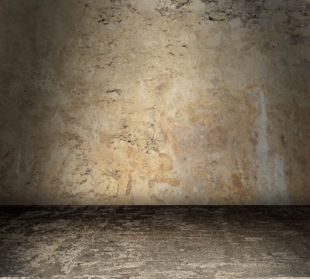 Grungy stained concrete room with bare walls photo