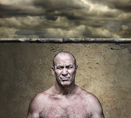 Scary big mean man scowling under a threatening sky