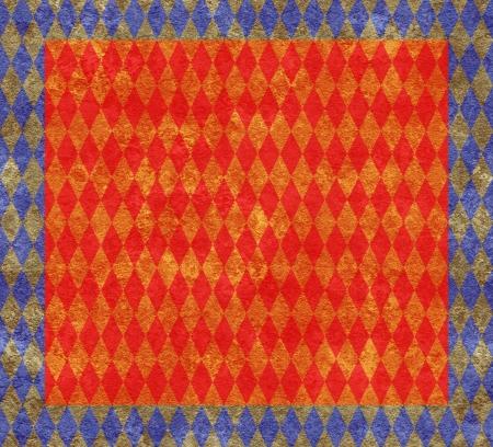 arlecchino: Elegante sfondo di arlecchino dorato sul rosso con un bordo blu Archivio Fotografico