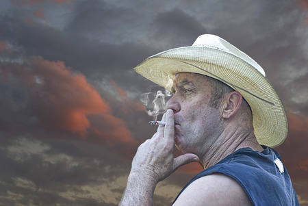 Cowboy relaxing with a cigarette at the end of the day