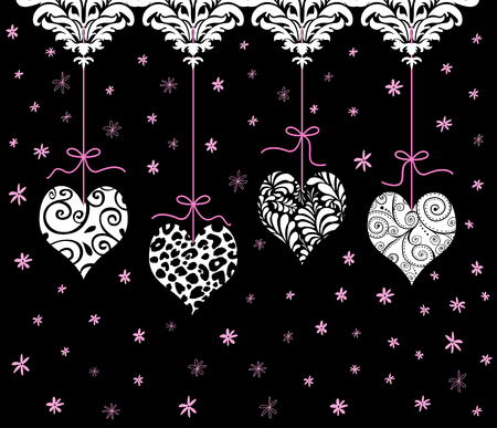 Four cute red Valentines hanging from pink ribbons