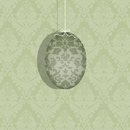 Pretty decorated Easter egg suspended on a white ribbon